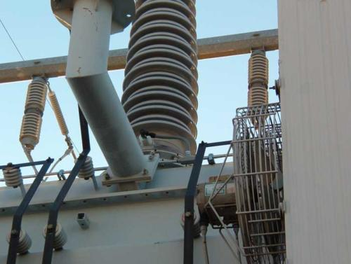 View of 230kV side rigid conduit and seal tight conduit system for bushing tap connection.